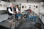 BAA STEAM teacher Ramiro Gonzalez looking at printmaking equipment with APS Executive Director Kim Berman