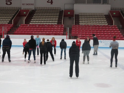 Students learning to figure skate during intersession.