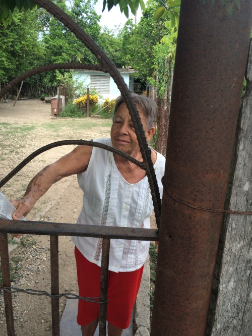 Margarita's Aunt Rosario opening the gate to the house in Cienfuegos.
